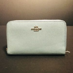 Used Teal Coach wallet